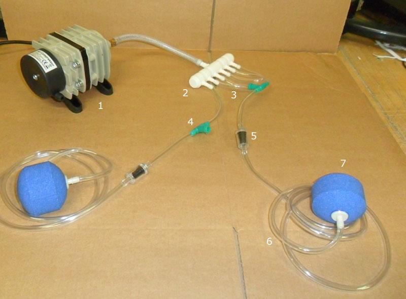 Montage du système d'aération de bassin avec compresseur